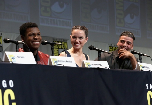 "(L-R) Actors John Boyega, Daisy Ridley and Oscar Isaac at the Hall H Panel for ""Star Wars: The Force Awakens"" (Photo by Jesse Grant/Getty Images for Disney)"